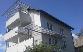 Nadstrešek nad terasama pri stanovanjskem objektu-nadstreski-teras-in-balkonov-kljucavnicarstvo-marincic-categories_4_356